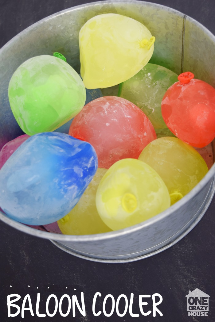 frozen balloon cooler filled with colorful balloons