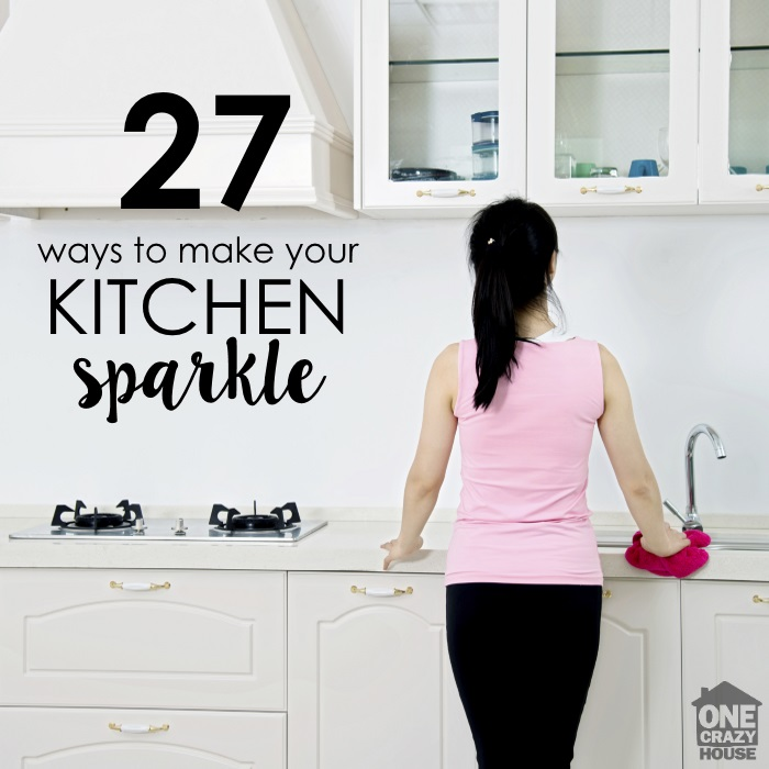 woman cleaning her kitchen while following the spring cleaning list