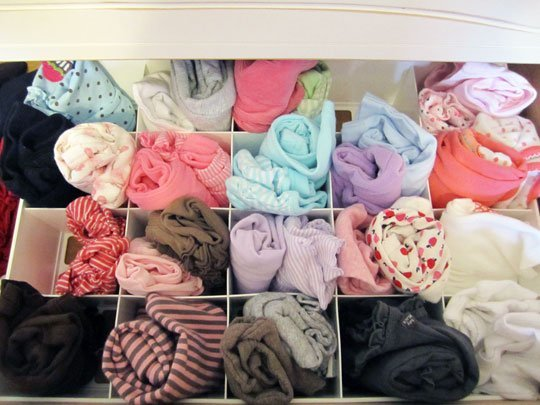 organize baby clothes with an ornament box