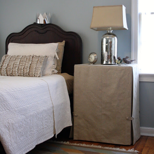 nightstands and other small tables are clutter magnets. Create hidden storage by hiding them under a fabric skirt.