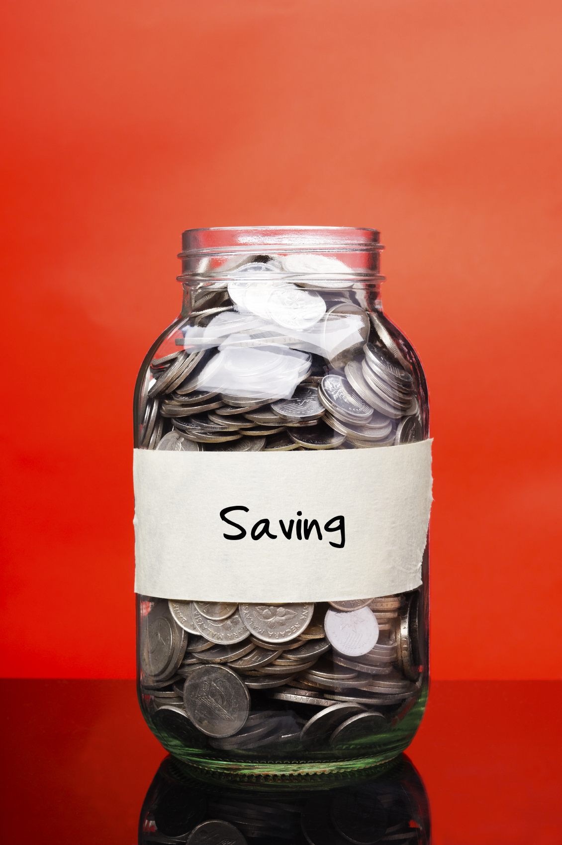 Saving label on glass jar with coins