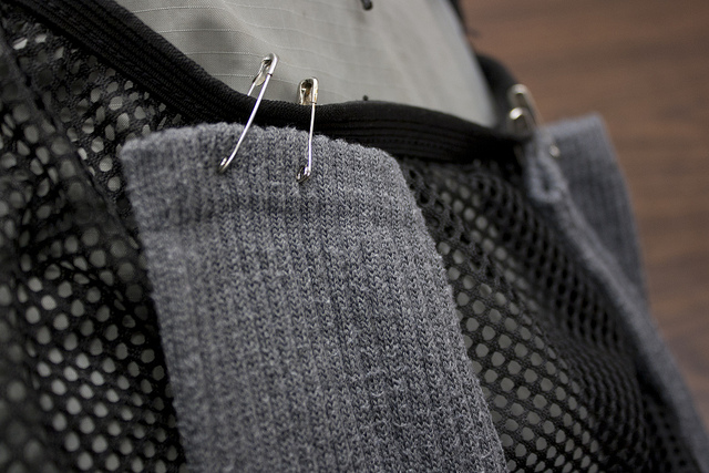 pin socks to backpack