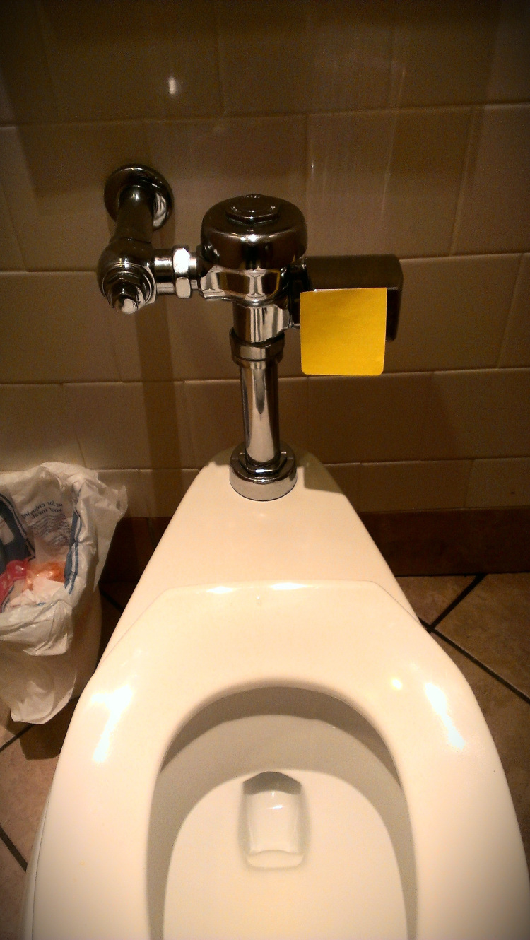 sticky note on automatic toilet