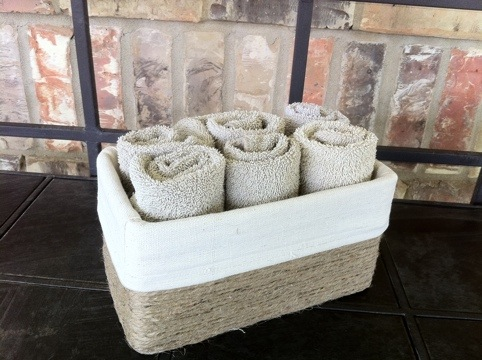 can you believe this towel holder was an old kleenex box wrap it in jute fold a little bit of canvas over the sides and cover the inside with canvas