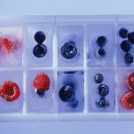freezing fruit in an ice cube tray