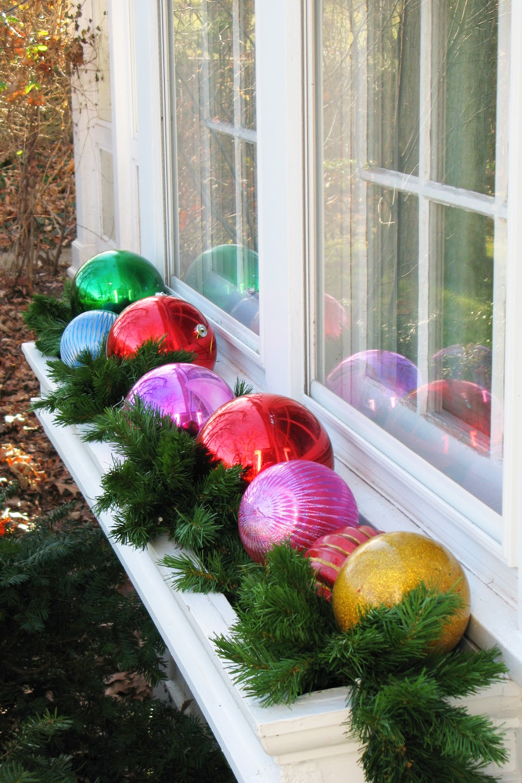 window-box-full-of-colorful ornaments are just one of the many fun Christmas yard decoration ideas