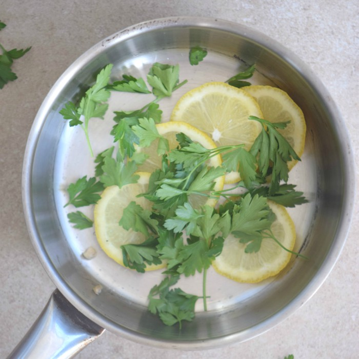 This lemon parsley air freshener will leave your kitchen smelling fresh and clean.