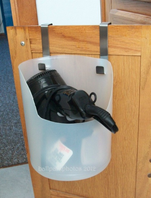 or cut out a plastic jug and put it on hooks to store your hair dryer great way to save a few bucks - Bathroom Under Sink Storage Ideas