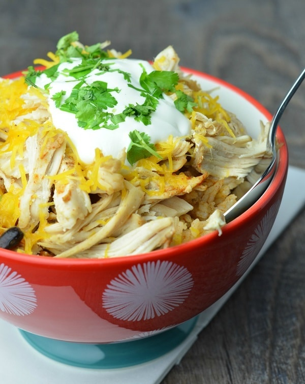chicken taco bowl ingredients in a bowl with a spoon