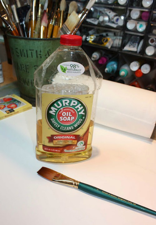 bottle of Murphy's Oils Soap and a paintbrush.