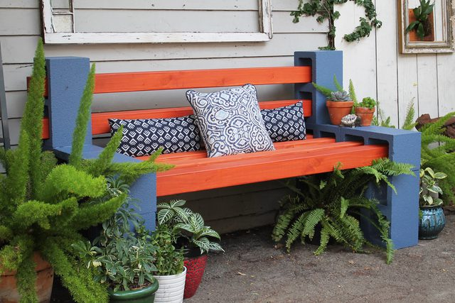 There's no need to spend hundreds or thousands of dollars on patio  furniture when you can create fun, practical pieces with cinder blocks and  wooden posts.