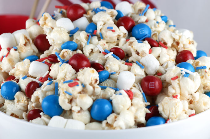 popped popcorn with red white and blue sprinkles and m&ms