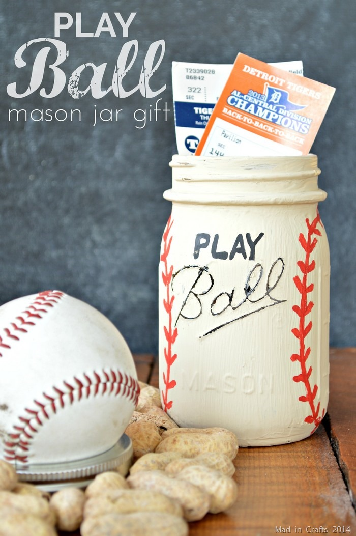 mason jar painted like a baseball with sporting event tickets poking out of the top of the jar