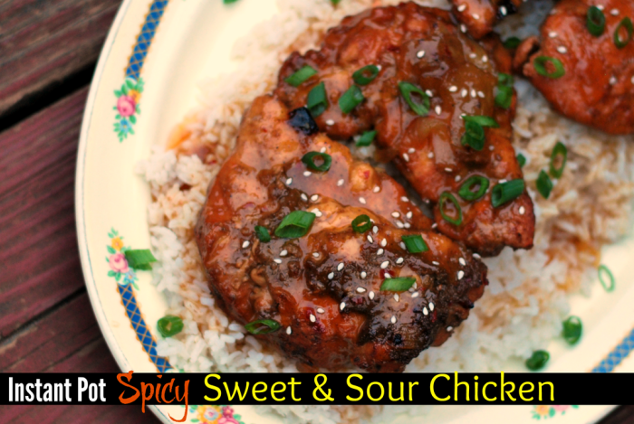 platter with white rice and spicy sweet and sour chicken on top