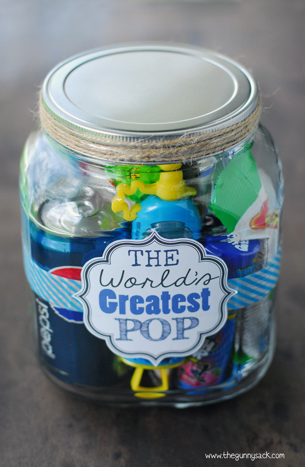 "mason jar filled with ""pop"" themed items and a label that says ""The World's Greatest Pop"""
