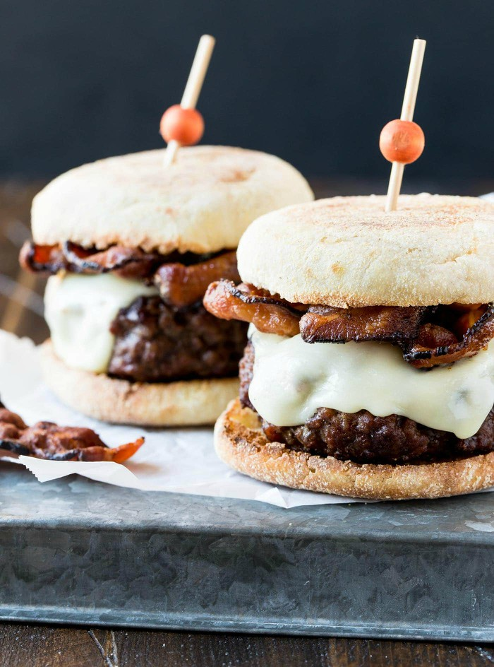 close up of two Guinness burgers with melted cheddar and bacon