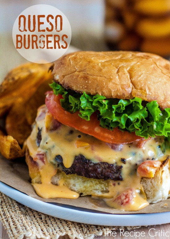 close up of burger loaded with lettuce, tomato, and queso