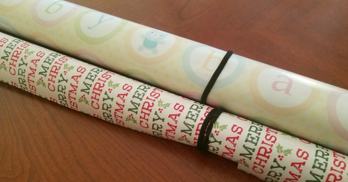 Keep gift wrap organized with rubber bands