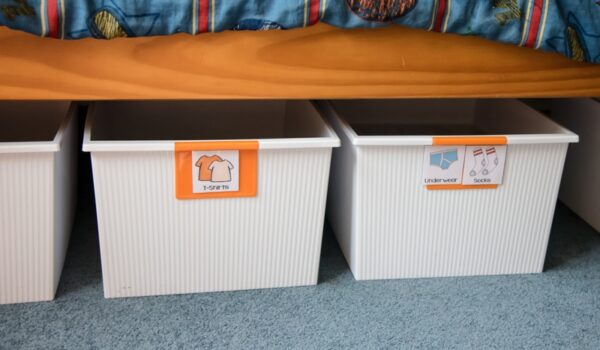 how to organize kids clothes in bins under the bed