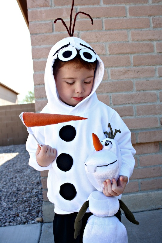 Boy dressed in homemade Olaf Costume