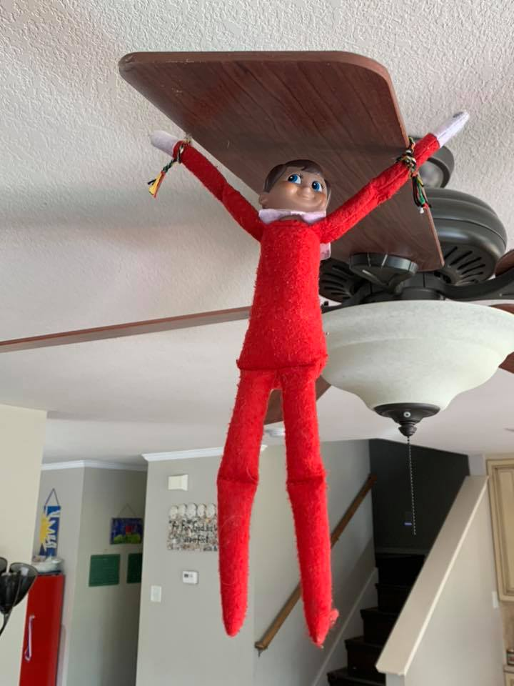 Elf On The Shelf Swinging From Fan