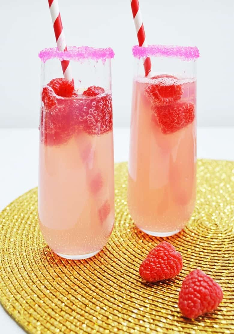 mimosa in glass with raspberries