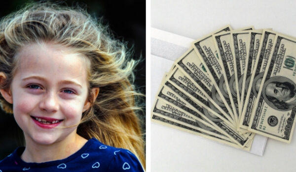 little girl smiling and pile of money