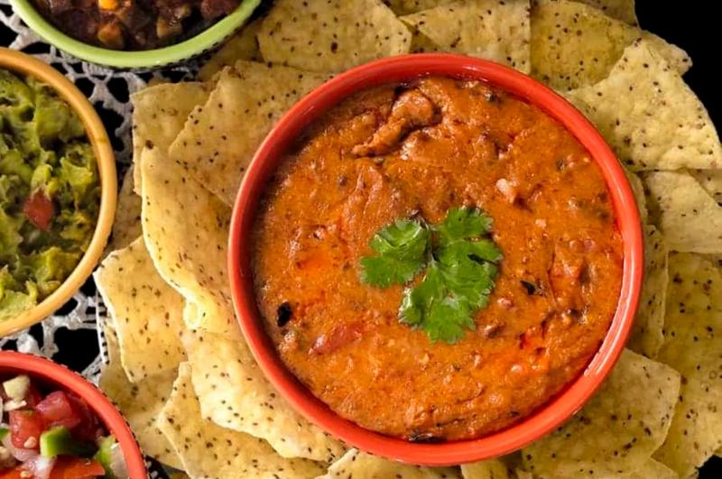 Enjoy Mexican appetizers like this enchilada dip