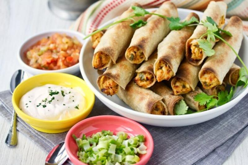 Enjoy Mexican appetizers like these taquitos