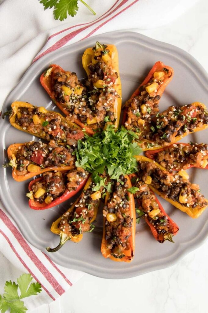 Enjoy Mexican appetizers like these mini stuffed peppers