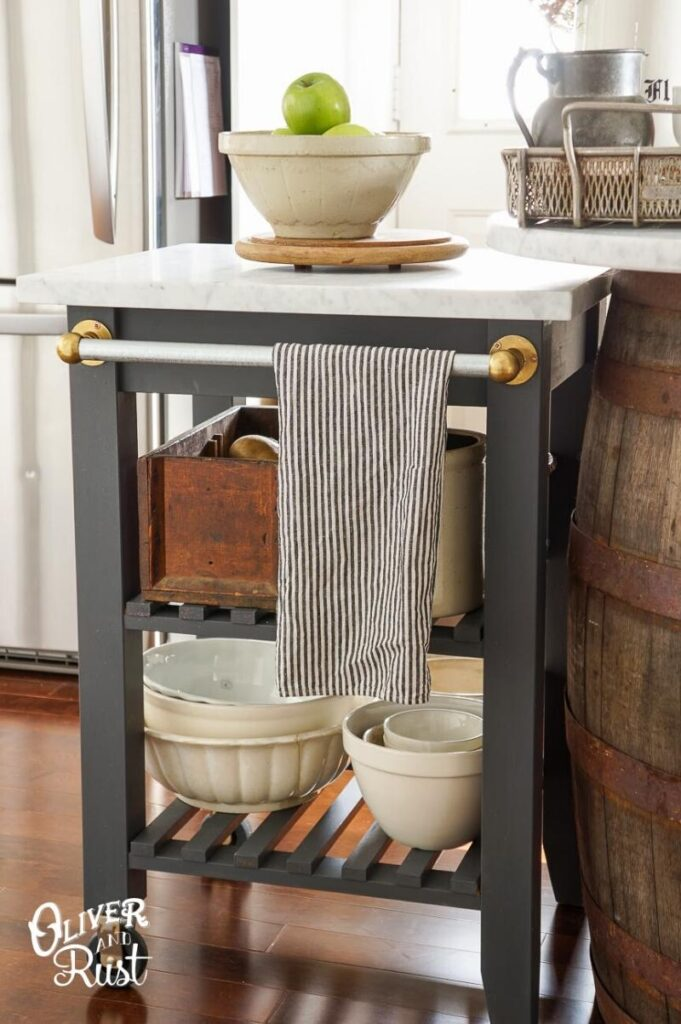dark grey farmhouse style kitchen cart with white marble top