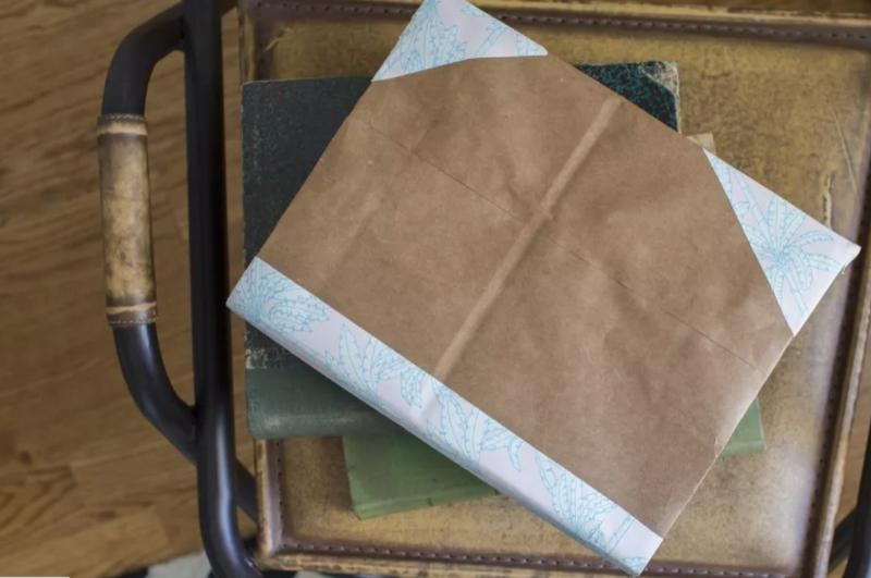 Textbook with a brown paper bag cover.
