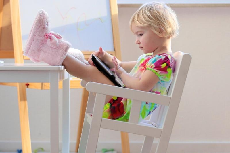 toddler using ipad to play fun learning games for kids
