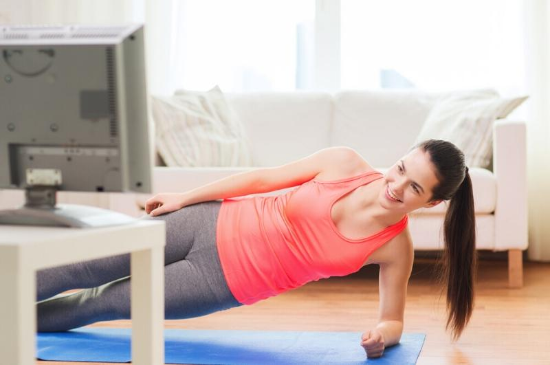 lady practicing self care through fitness at home