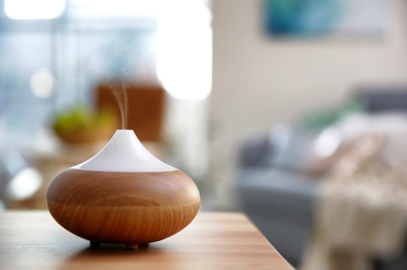 essential oil diffuser releasing mist into the air
