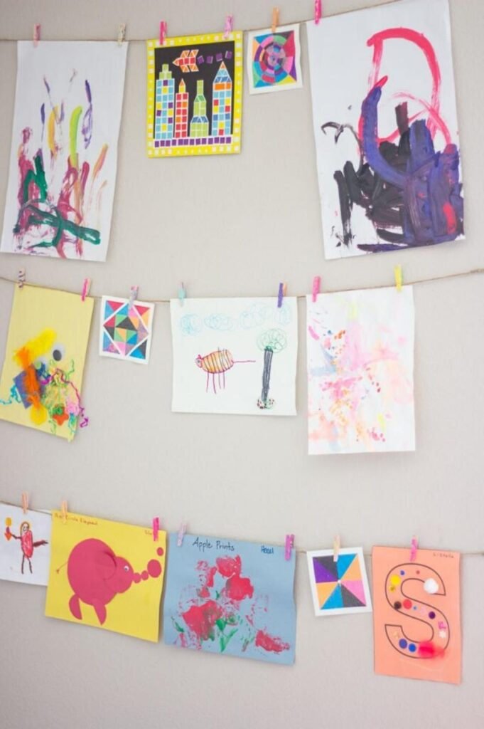 kids art hanging on walls from DIY twine ropes and clothespins