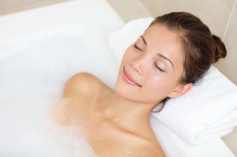 woman relaxing in a warm bath as a mood booster