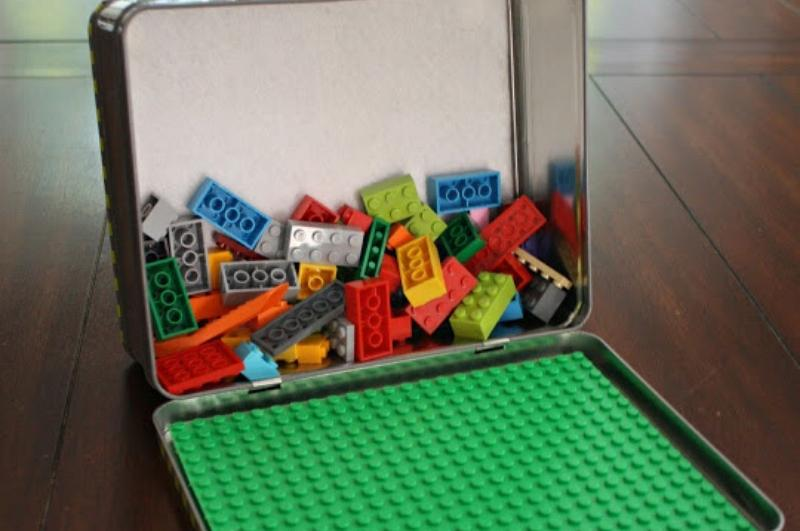 metal lunchbox with Lego board and Legos