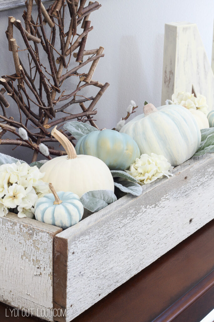 vintage painted faux pumpkins styled together in a wood box