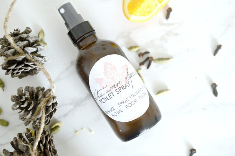 bottle of autumn spice toilet spray with pinecones, cloves and lemon