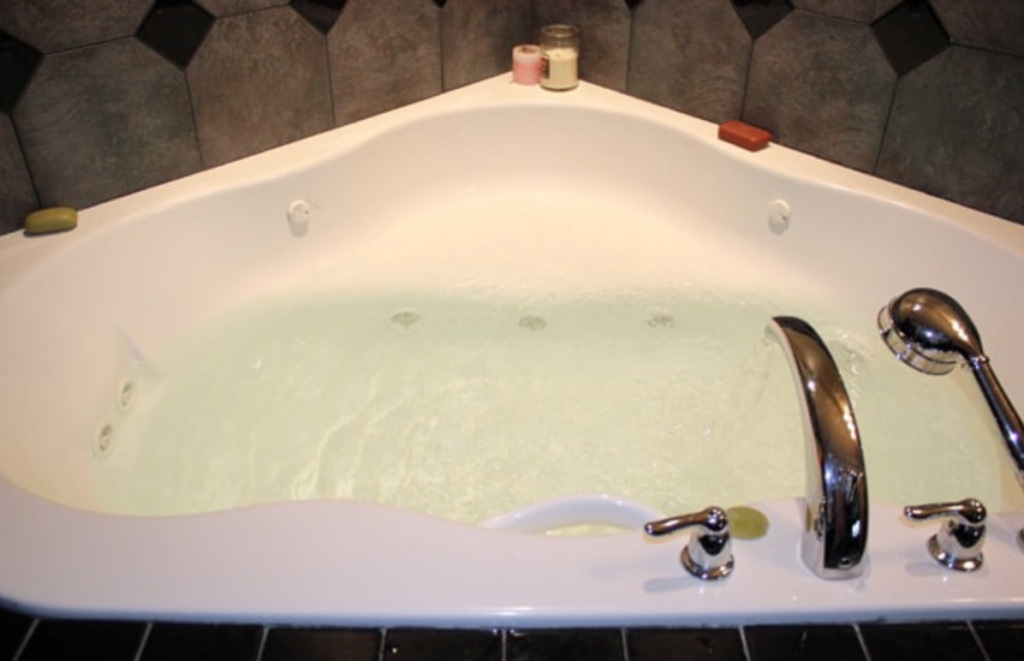 clean jetted tub filling with water