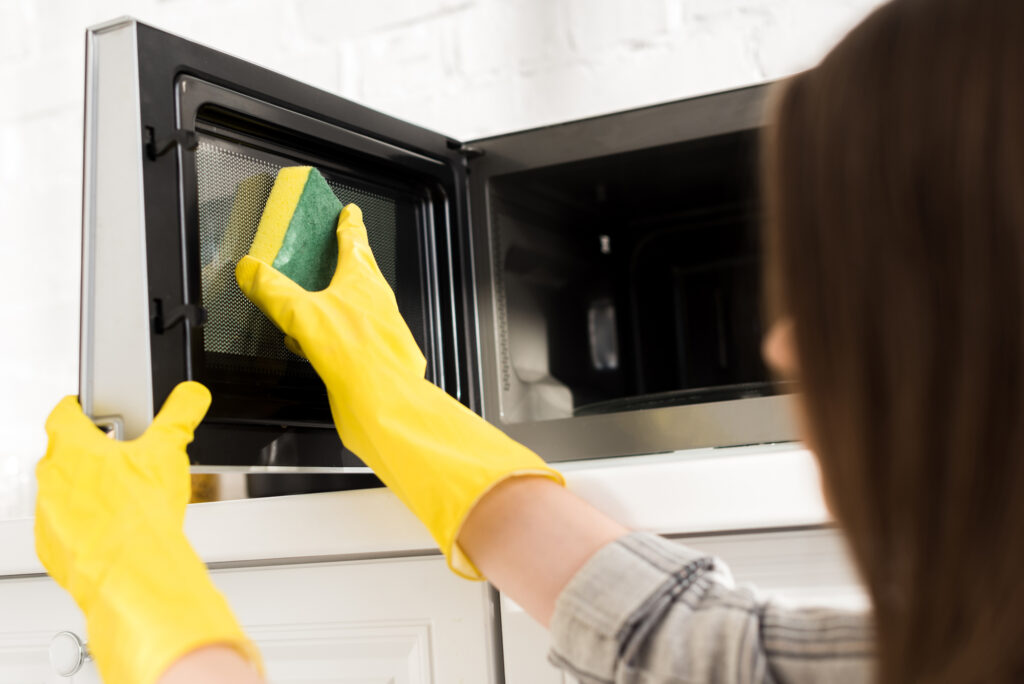how to clean microwaves with gloves and a sponge
