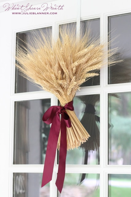 wheat sheave fall wreath hanging on a door