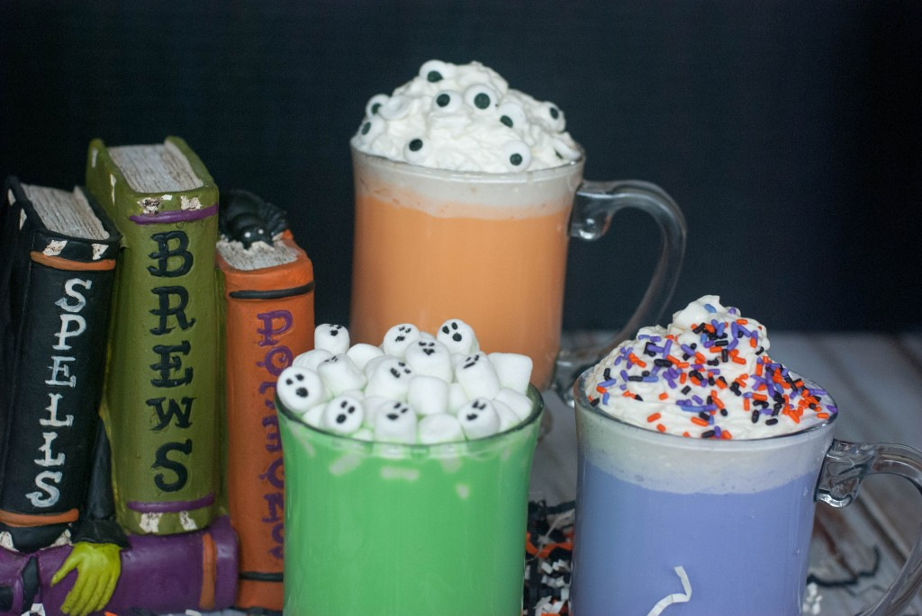 colored Halloween hot chocolate in mugs