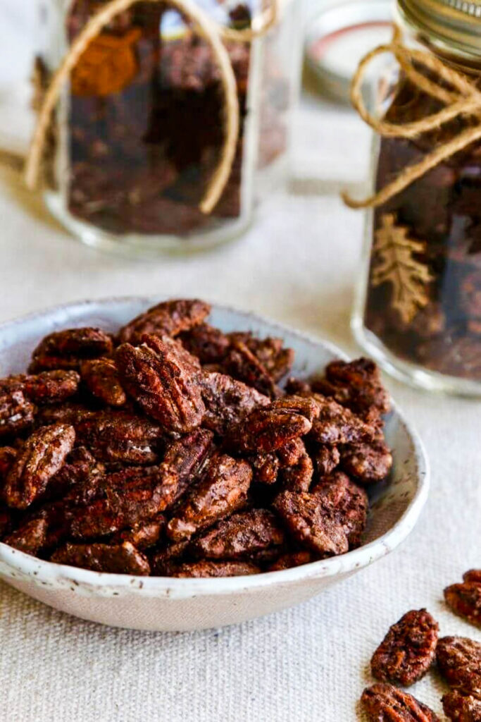 bowl of spiced candied pecans