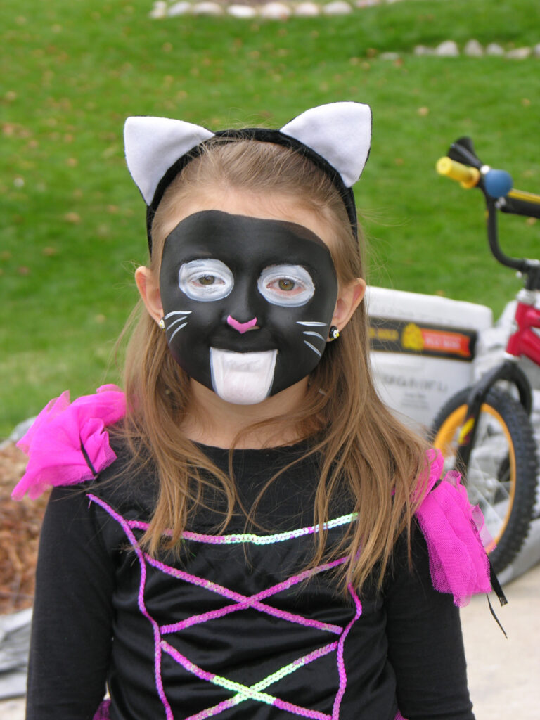 girl with black cat face paint