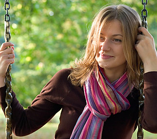Woman wearing a scarf tied in the classic European style