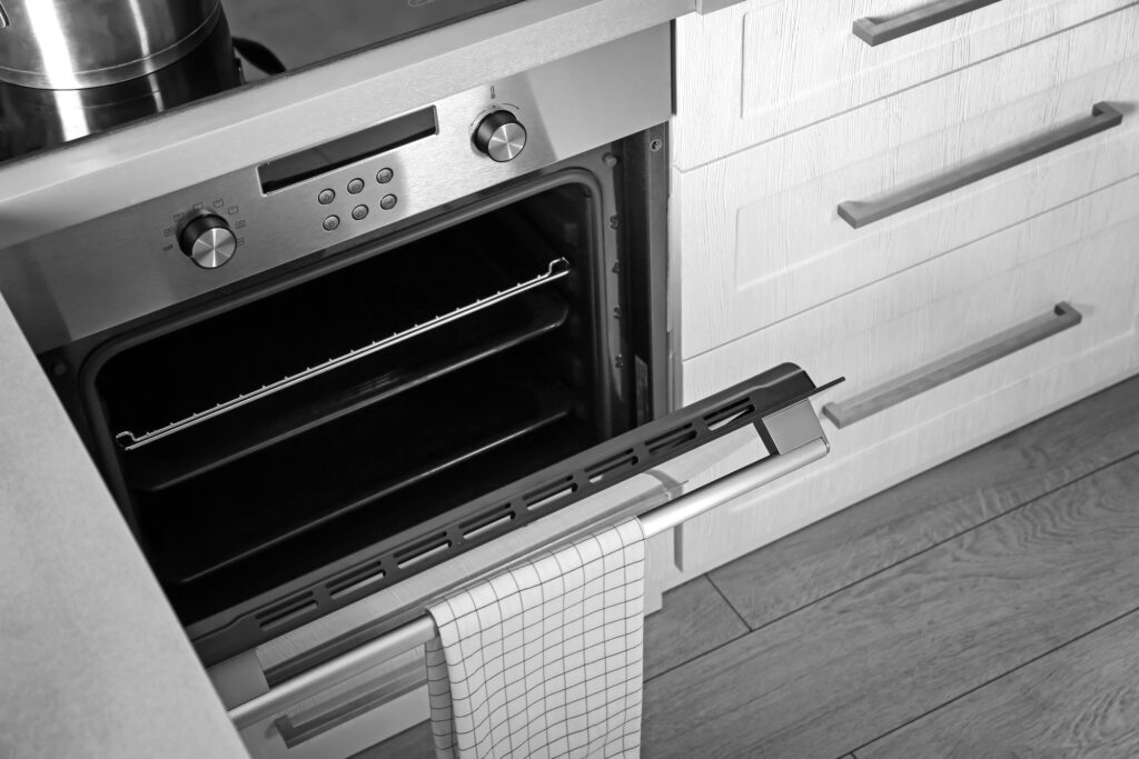 Close up of a kitchen oven with the door open