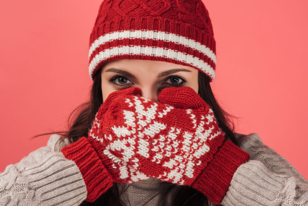 woman wearing red and white winter hat and gloves