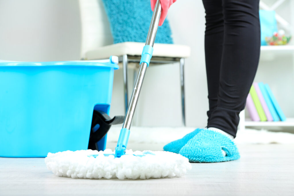 woman mopping the floor closeup